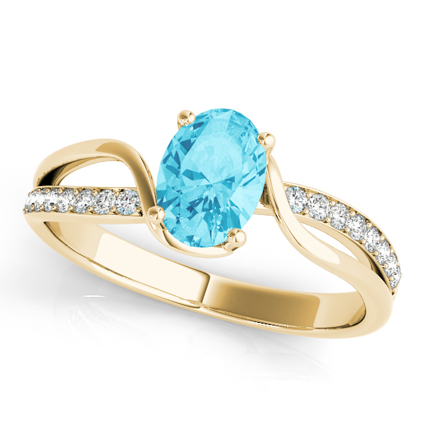 Swirl Oval Blue Topaz Ring Yellow Gold