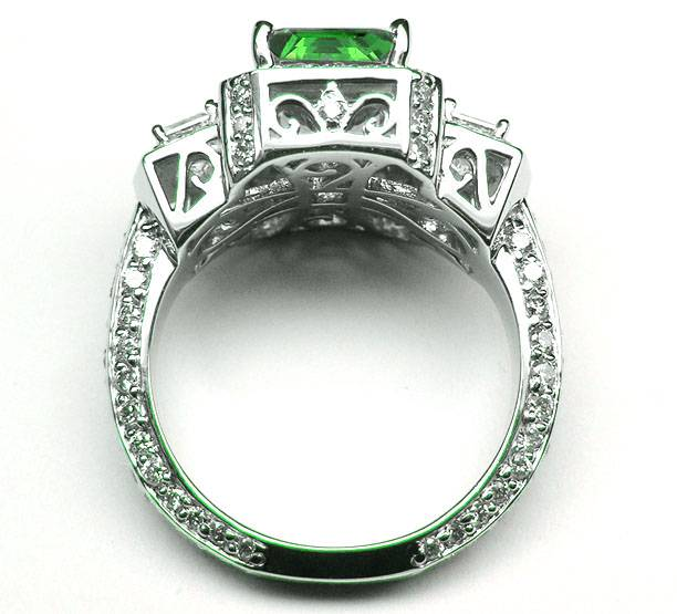 Emerald Cut Green Emerald Vintage Design Halo Ring with trapezoids sides