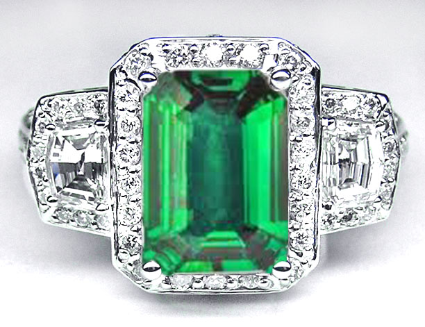 Emerald Cut Emerald Vintage Design Halo Ring with trapezoids side stones