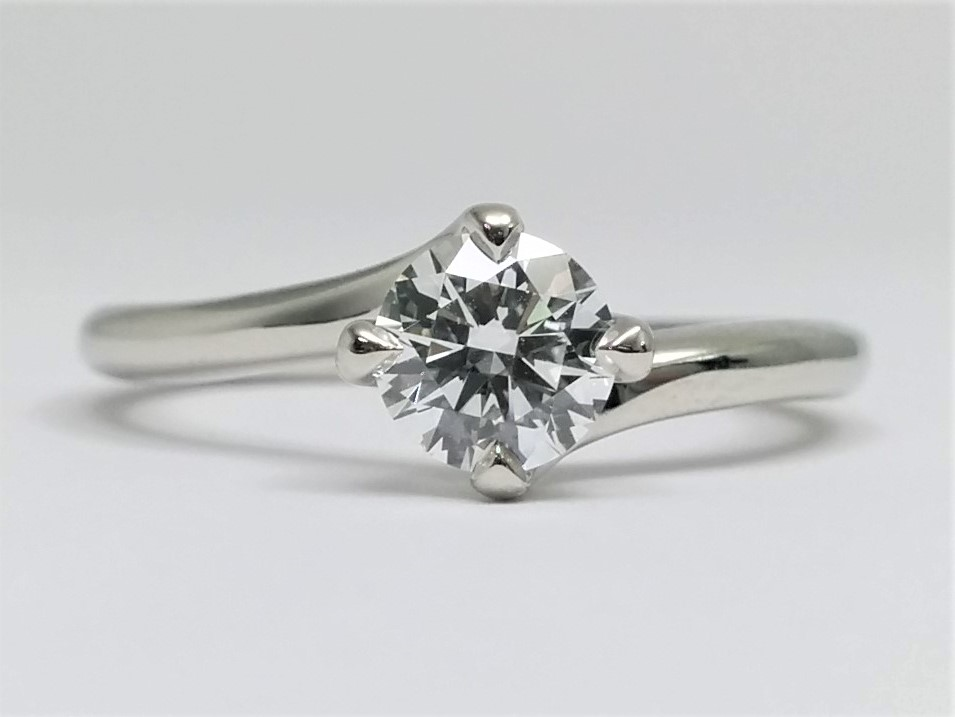 Delicate Swirl Solitaire Diamond Engagement Ring