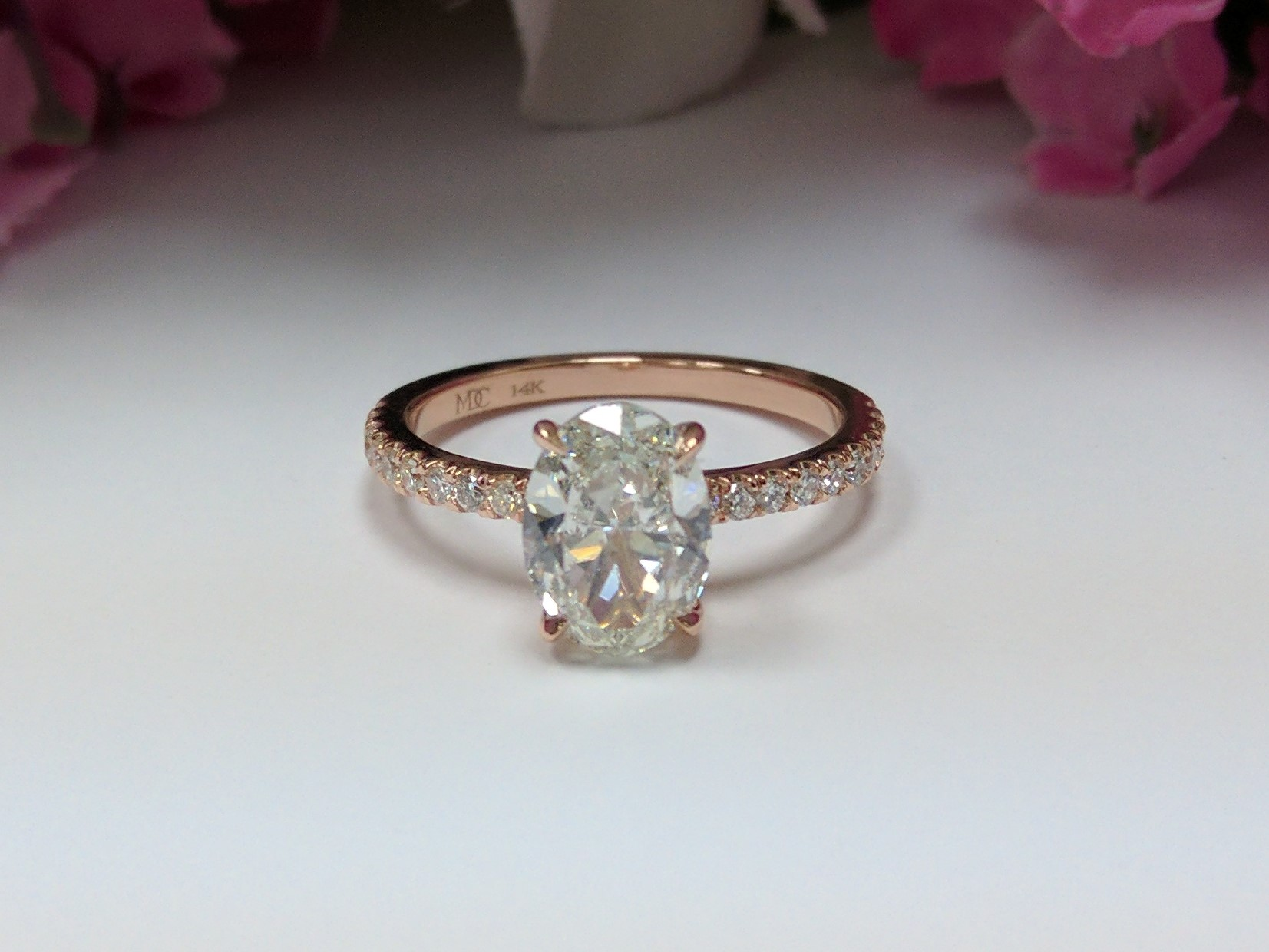 Delicate Low Profile Oval Diamond Engagement Ring in Rose Gold