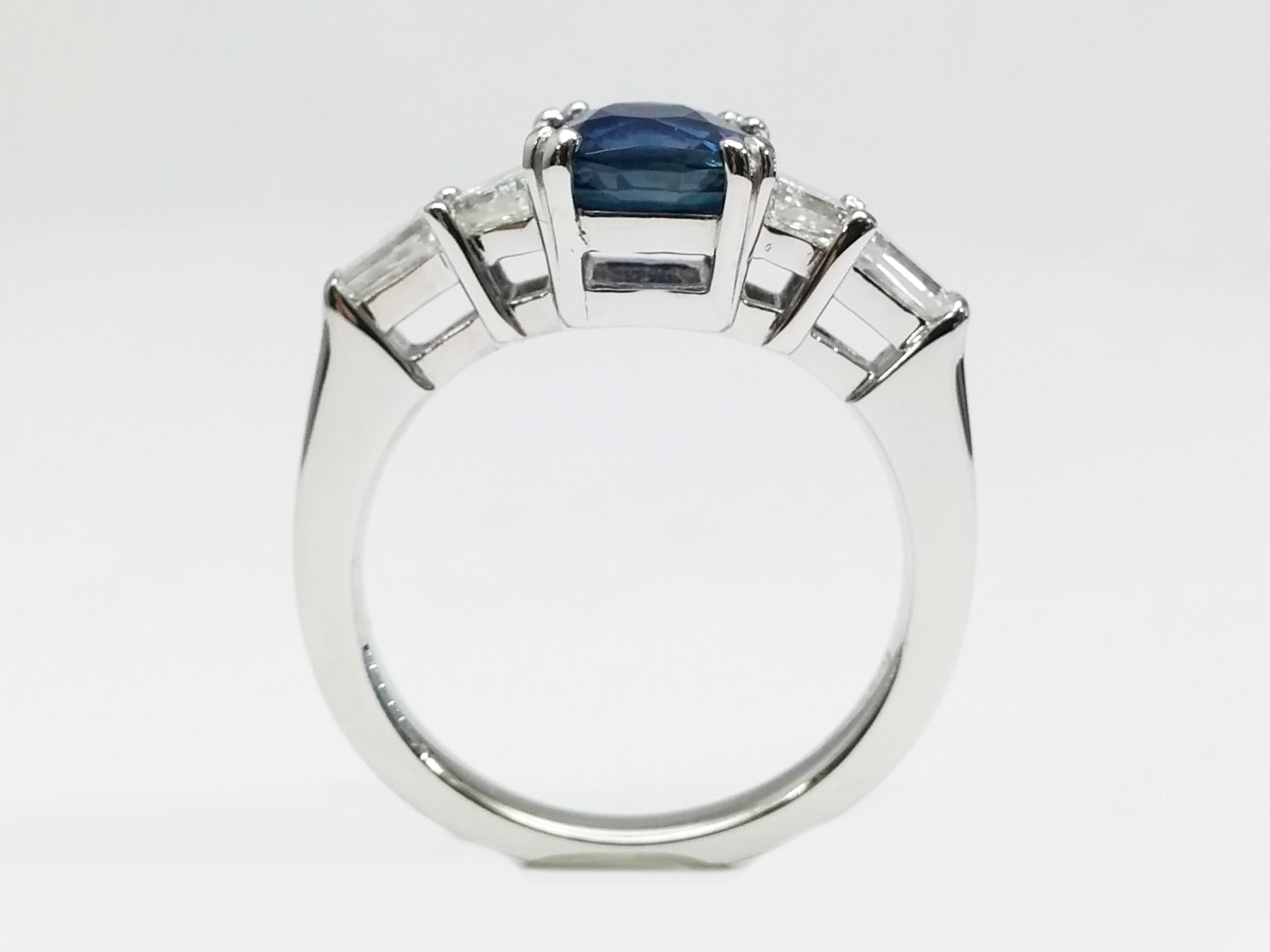 Cushion Cut Blue Sapphire Engagement Ring with Trapezoids and Baguettes